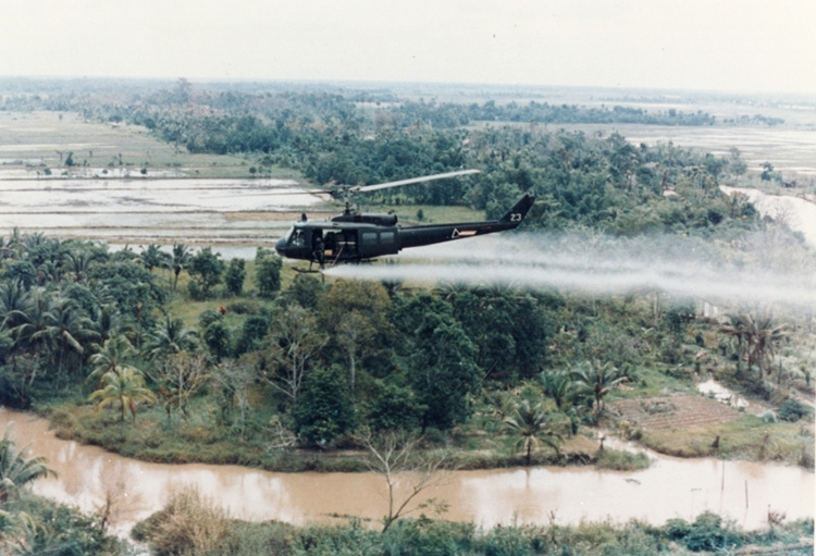 US helicopter spraying Agent Orange during the Vietnam War.