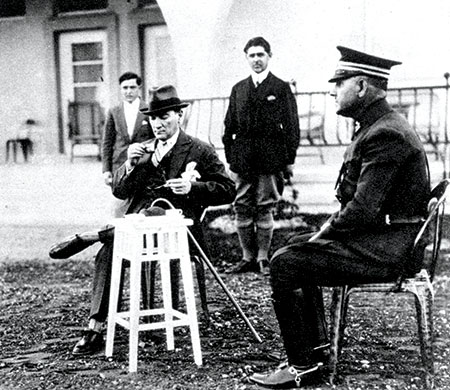 Mustafa Kemal Atatürk drinking coffee at his farm near Ankara, August 3rd, 1929. Copyright aka-images
