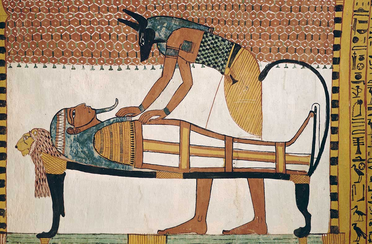 Anubis attending Sennedjem's mummy, c.1292-1187 BC © Bridgeman Images.