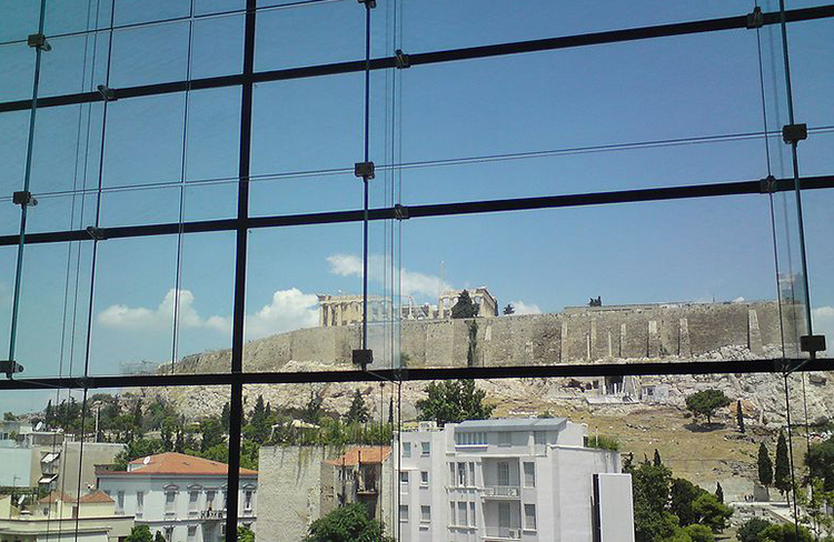 The Acropolis seen from the interior of the Acropolis Museum, Athens.