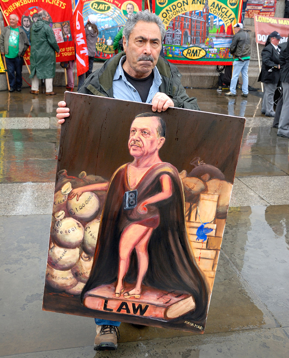 Artist Kaya Mar with satirical painting 'Erdoğan, the Turkish Sun King', London, 1 May 2014.