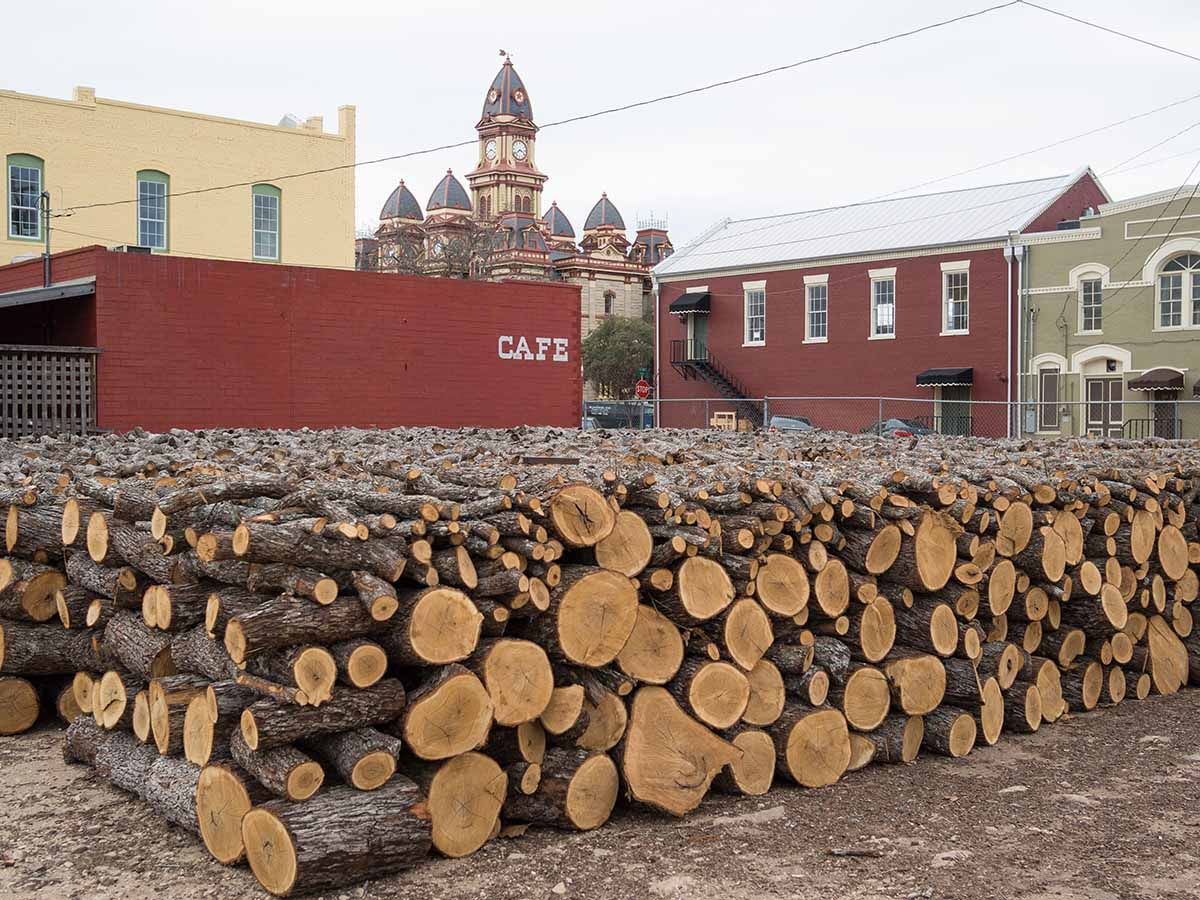 Firewood stacked outside Smitty's Market, Lockhart, 2012. Alamy.