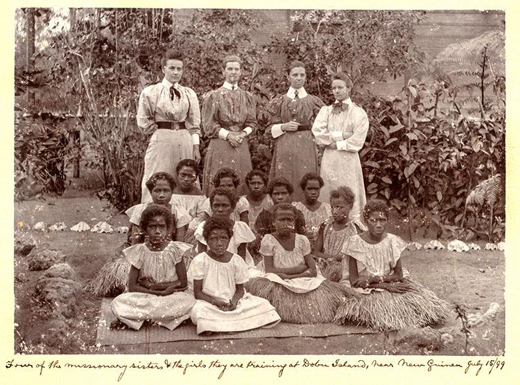 Missionaries and Islanders, Dobu, 1899.