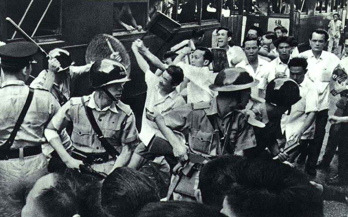 August 1967: Police clash with protestors at the Hong Kong tram workers strike. Wiki Commons.