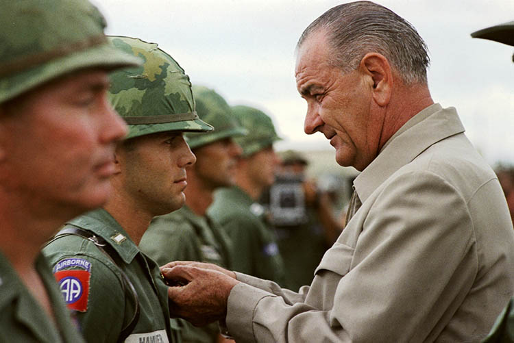 President Lyndon B. Johnson awards the Distinguished Service Cross to First Lieutenant Marty A. Hammer, in Vietnam, 1966.