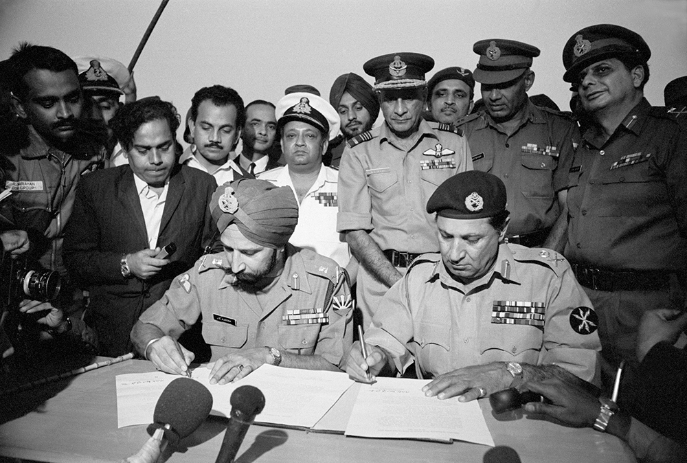 Lt Gen Jagit Singh Aurora, (left) and Lt Gen Amir Abdullah Khan Niazi sign the peace treaty that turned East Pakistan into Bangladesh, Dhaka, 1971.