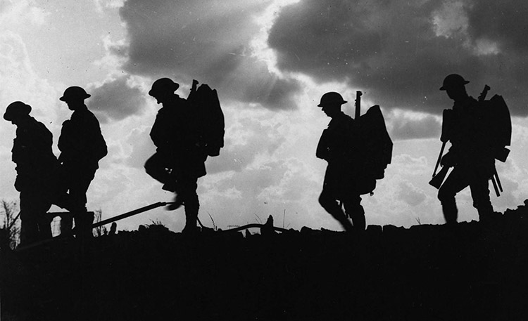 British soldiers moving forward during the Battle of Broodseinde. Photo by Ernest Brooks.
