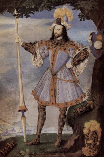 "George Clifford attired as the Knight of Pendragon Castle for the Tilt of 1590. His pageant shield leans against the tree. The Queen's ""favour"", a glove, is attached to his hat."