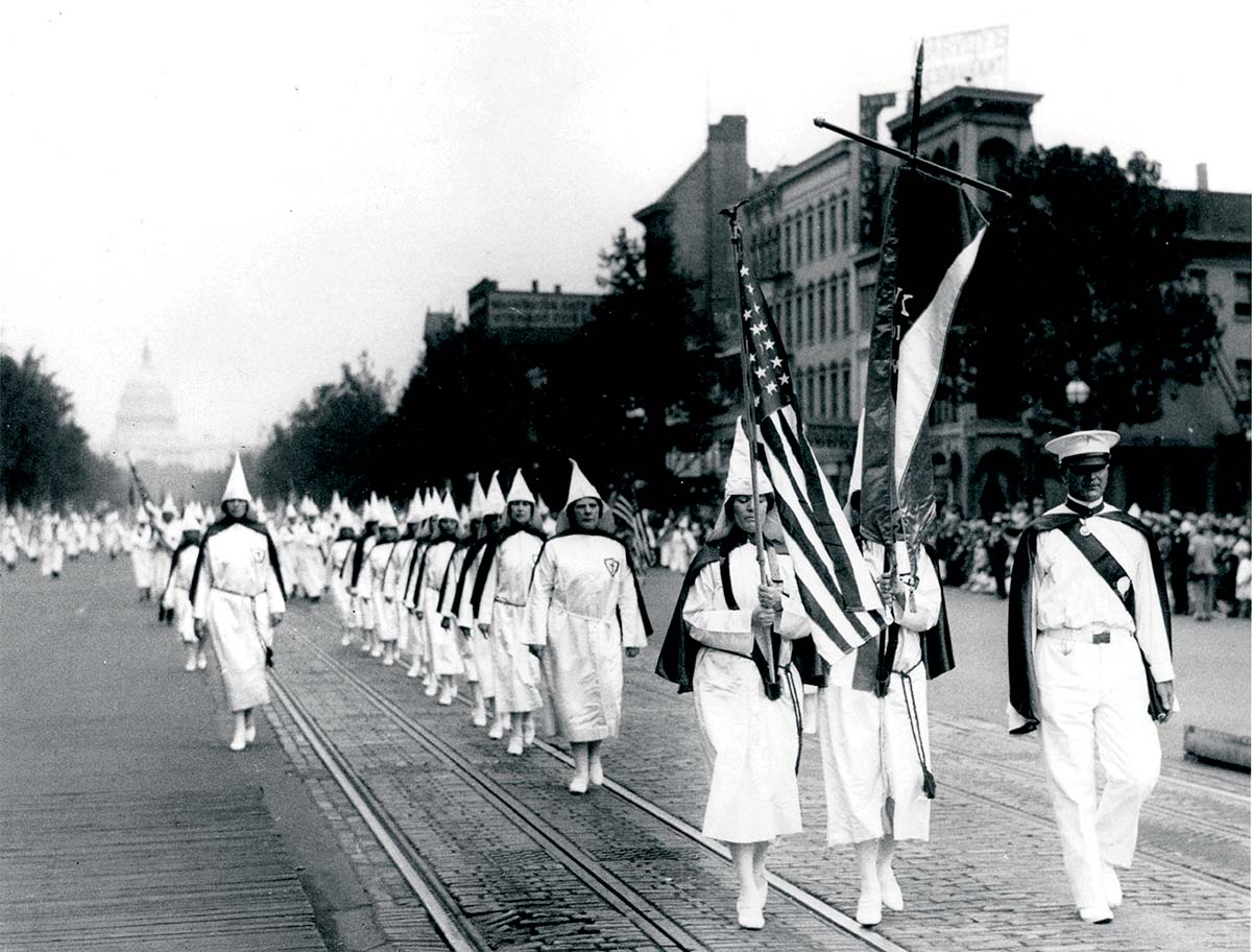 A line of women in  a Ku Klux Klan parade, Pennsylvania Avenue, Washington DC, 1928 © Getty Images