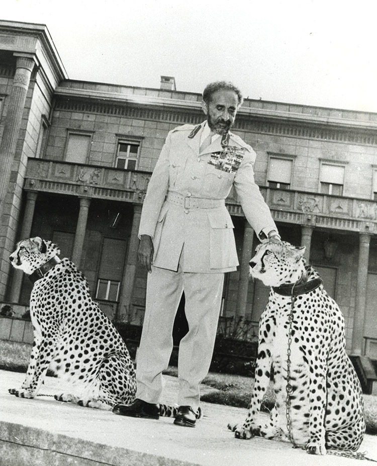 Haile Selassie with his pet cheetahs before the Jubilee Palace, Addis Ababa, c.1955.