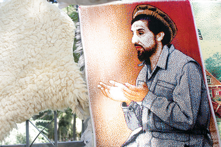 Massoud at prayer,  an image reproduced on a carpet for sale in Kabul's market, 2016.