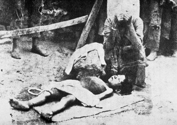 A woman mourns a child during the deportation of Armenians by the Turks, 1915. Getty Images/AFP