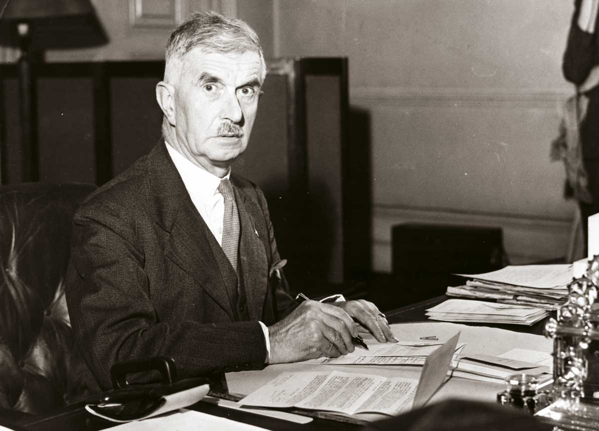 Home Secretary James Chuter Ede at his desk, c.1950 © Hulton Getty Images.