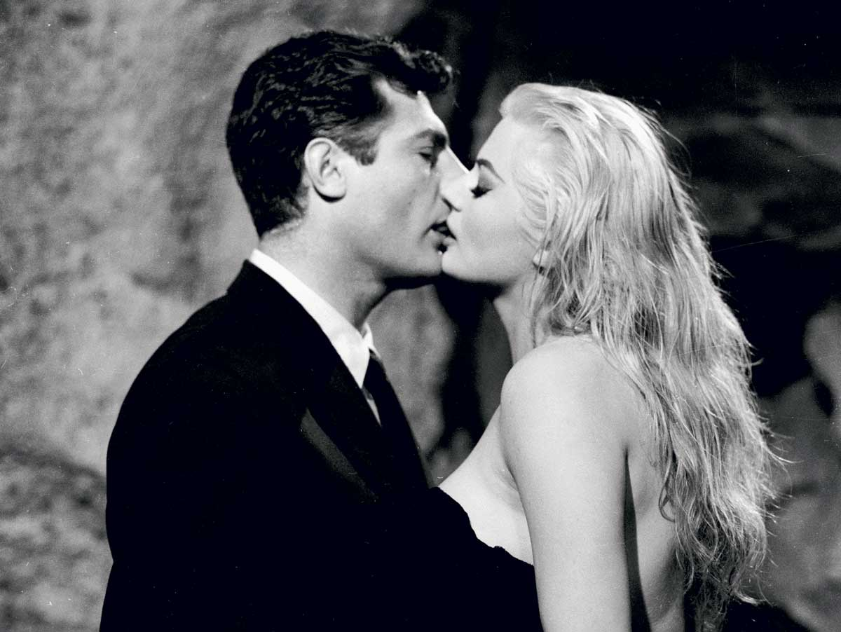 Marcello Mastroianni and Anita Ekberg in La Dolce Vita, 1960. Still from La Dolce Vita (Pathé, 1960). Directed by Federico Fellini. Produced by Giuseppe Amato and Angelo Rizzoli. Cinematography by Otello Martelli. Photo © John Kobal Foundation/Getty.