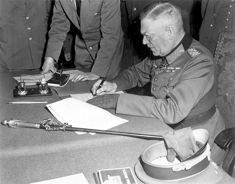 Field Marshal Wilhelm Keitel signing the ratified surrender terms for the German military in Berlin.