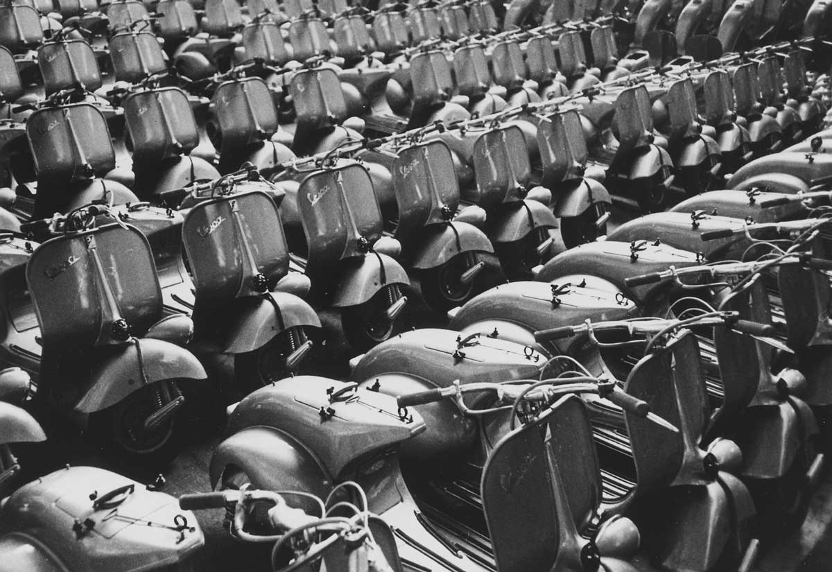 'Italy. With the help of Marshall Plan funds, a new product rolled out of the factory, the Vespa Piaggio plant at Pontedera near Pisa, Italy.' c. 1948-1955. US National Archives.