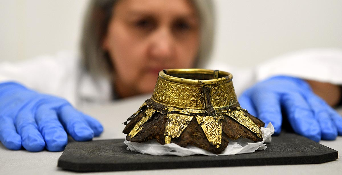 Conservator Claire Reed with the remains of a drinking vessel discovered at Prittlewell, Essex, in 2003 © Press Association Images