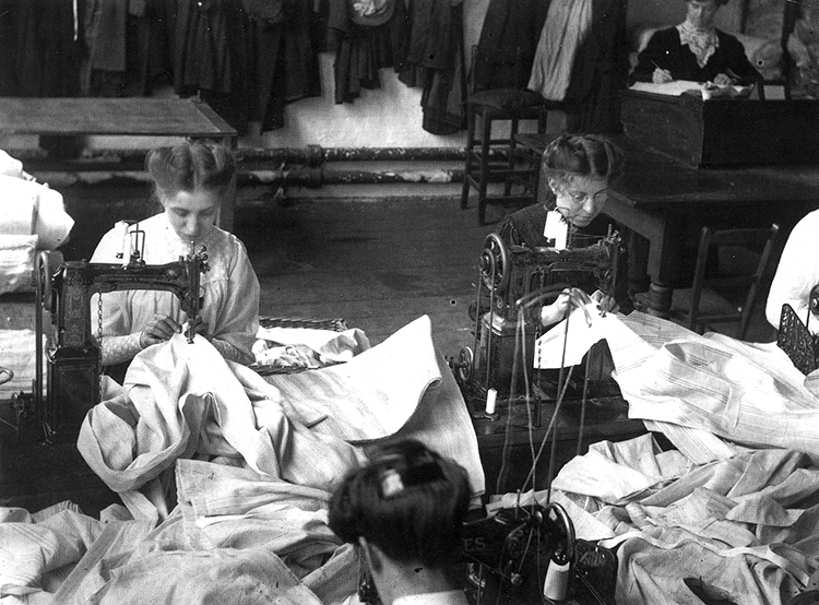Manchester factory girls making men's shirts on Wheeler & Wilson machines, 1909.
