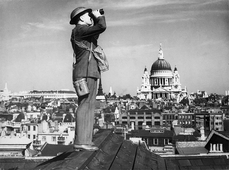 A Royal Observer Corps spotter scans the skies of London