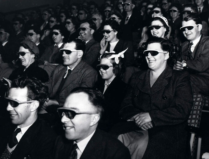 Audience wearing special glasses watch a 3D 'stereoscopic film' at the Telekinema on the South Bank in London during the Festival of Britain.