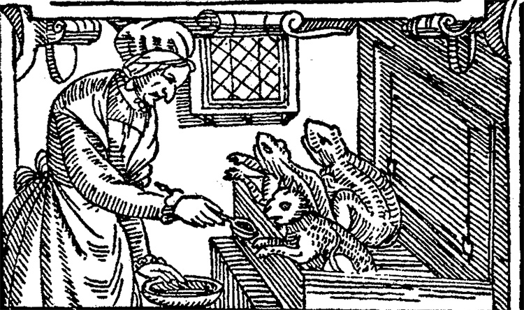 A witch feeding her toad-imps in a 1630 woodcut.