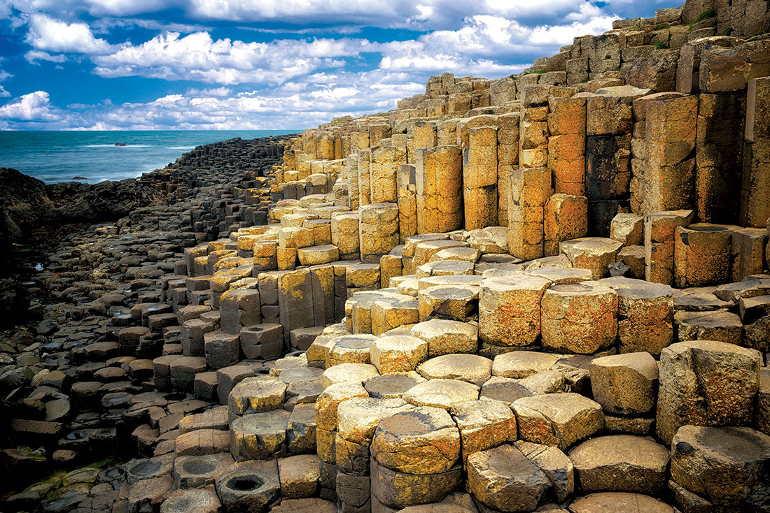 Giant's Causeway, Antrim. According to the Fenian Cycle, Fionn mac Cumhaill, an Irish giant, was challenged to a fight by his Scottish rival Benandonner. Accepting the challenge, he built the causeway so that they could meet.