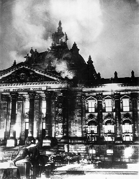 Firemen work on the burning Reichstag.