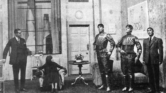A scene from Karel Čapek's 1920 play R.U.R. (Rossum's Universal Robots), showing three robots.