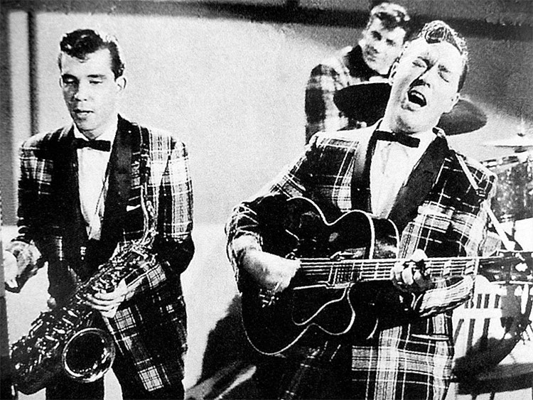 "Bill Haley and his Comets performing ""Rock Around the Clock"" on TV in 1955"