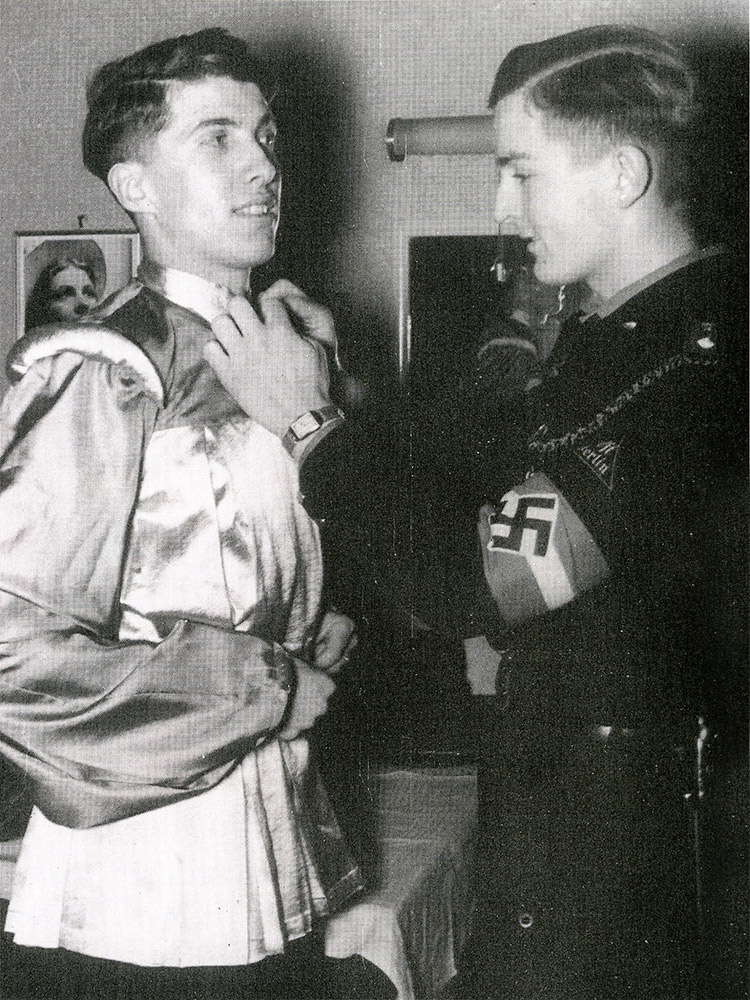 Two Hitler Youth members prepare for an amateur production of Shakespeare, June 1940
