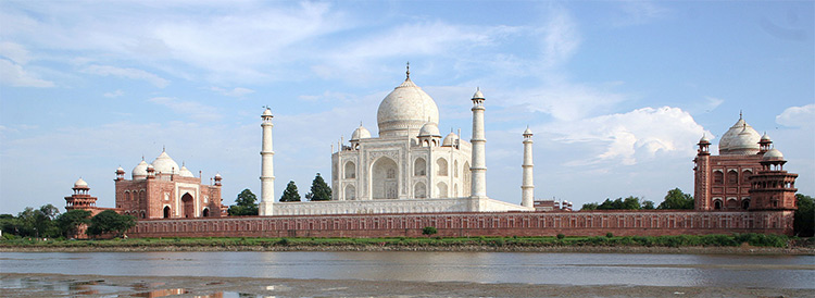 Taj Mahal and outlying buildings as seen from across the Yamuna River