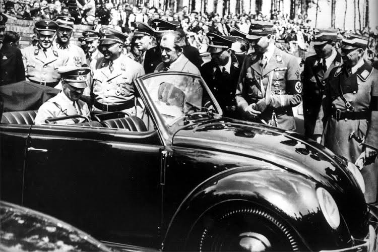 Hitler inside an early VW Beetle.