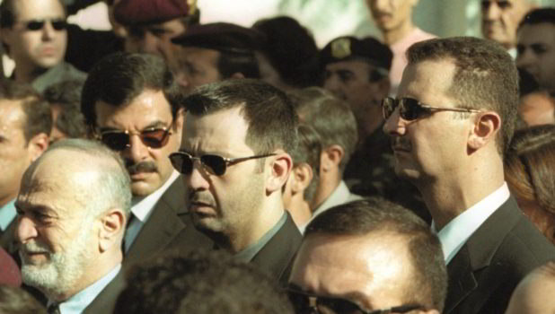 President Bashar al-Assad (right) and his brother Maher (centre) attend the funeral of their father Hafez, Damascus, June 13th 2000 (Getty/AFP/Ramzi Haidar)