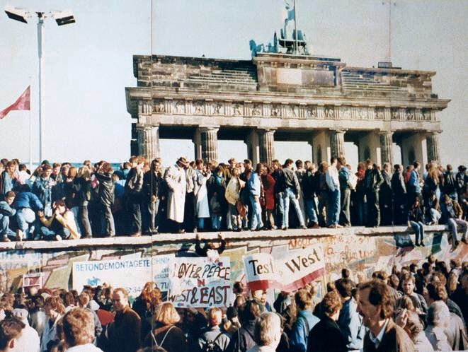 The Fall of the Berlin Wall, 1989. The photo shows a part of a public photo documentation wall at Former Check Point Charlie, Berlin.