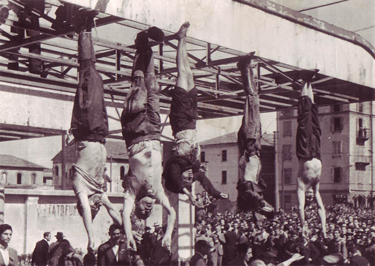 The dead body of Mussolini (second from left) next to Petacci (middle) and other executed fascists in Piazzale Loreto, Milan, 1945
