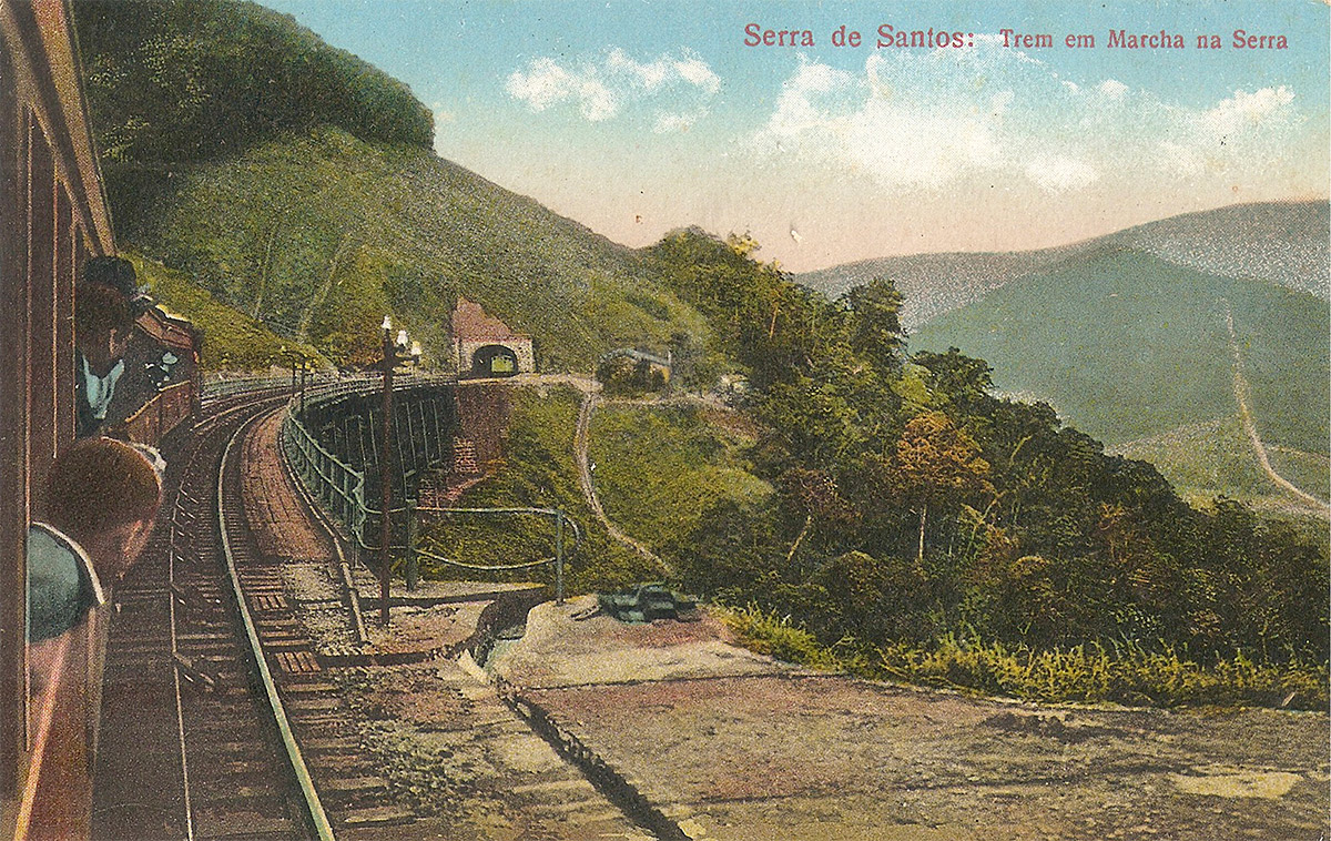 A hand-coloured postcard of an SPR train descending to the mouth of a tunnel.