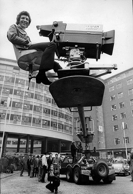 Singer Tom Jones rides a crane at BBC Television Centre, 1971.