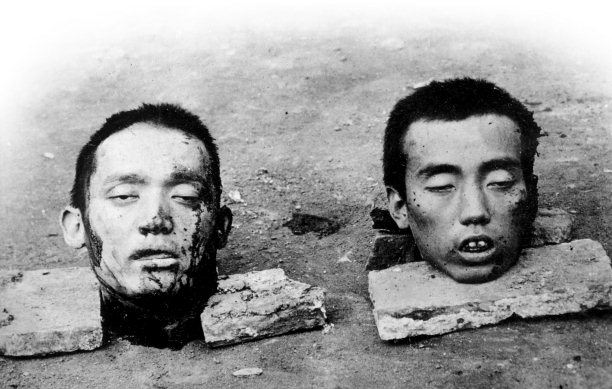 Chinese rebel leaders Liu Fuji (left) and Peng Chufan were arrested and beheaded early on October 10th. The Chinese displayed their heads as a warning, 'killing the chicken to scare the monkeys', but the Republican government honoured them as martyrs. Photograph by Francis Stafford.