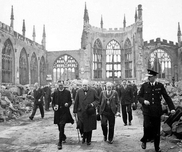 Winston Churchill visiting the ruins of Coventry Cathedral following its destruction in the Coventry Blitz of 14/15th November 1940.