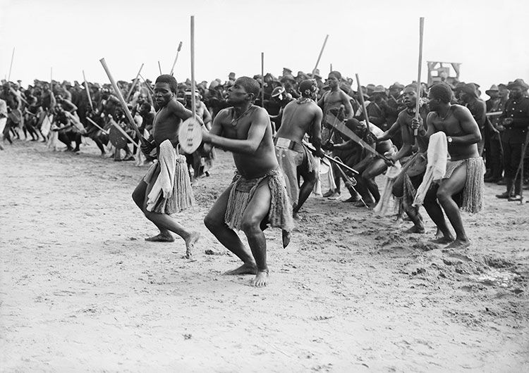 Soldiers of the South African Native Labour Corps perform a 'Zulu war dance'