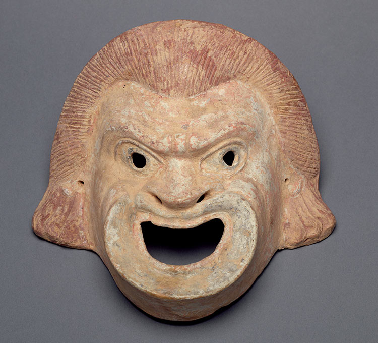 Greek comedy mask, terracotta, second century BC.