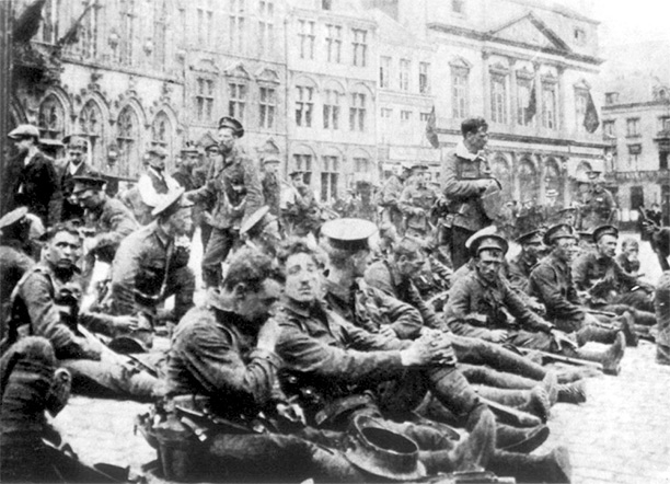 British troops from 4th Royal Fusiliers resting in the square at Mons 22 August 1914, the day before the Battle of Mons