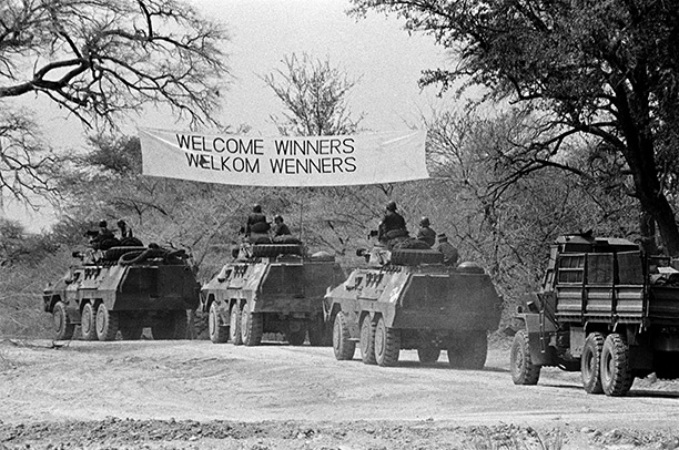 Victor's banner: John Liebenberg's photograph showing an SADF convoy entering Namibia, August 30th, 1988