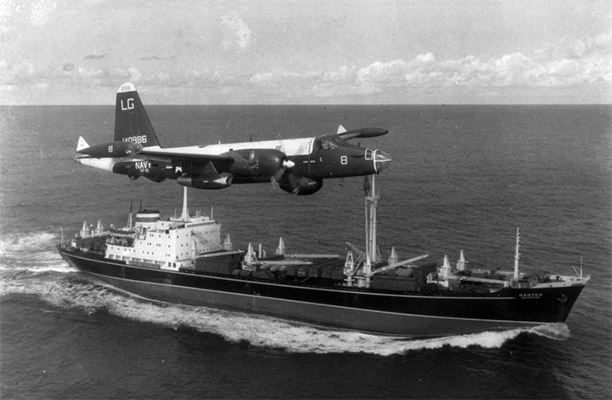 A US Navy P-2H Neptune of VP-18 flying over a Soviet cargo ship with crated Il-28s