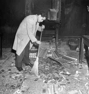 Sweeping old drachmas into a furnace, Athens, November 1944 (Getty Images / Time Life / Dimitri Kessel)