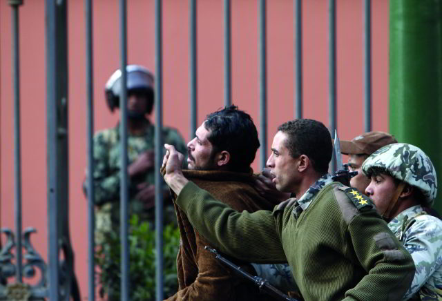 Egyptian soldiers arrest a suspected looter near the Cairo Museum, Jaunary 30th, 2011