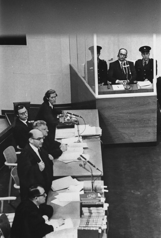 Adolf Eichmann sits in a glass booth as chief-prosecutor Gideon Hausner addresses the court in Jerusalem. Getty Images/Time Life