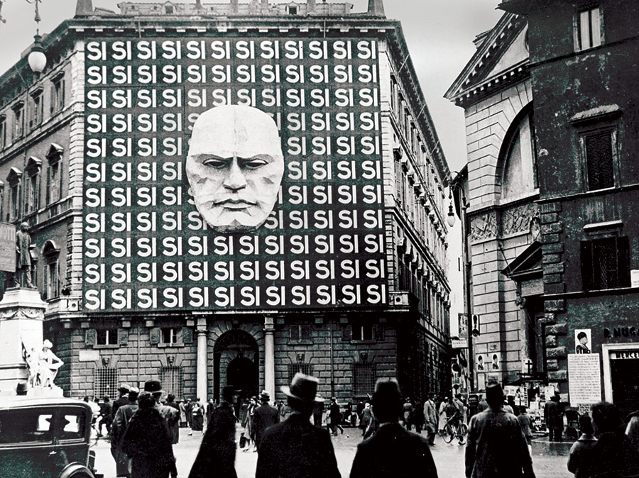 Yes man: mask of Mussolini on the façade of the Fascist Part Headquarters, Rome, 1934.