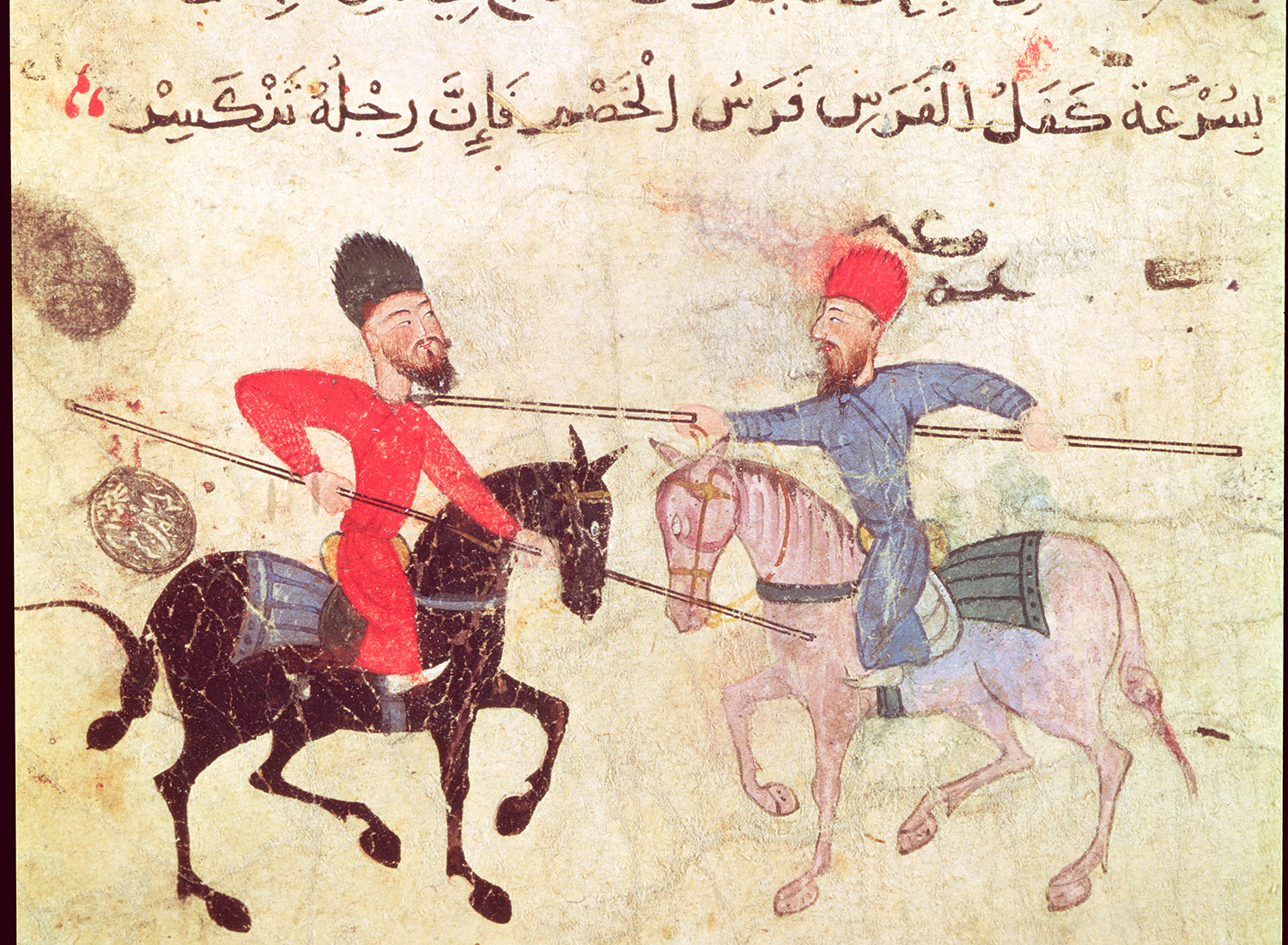 Two men duelling on horseback, Egyptian manuscript from Fustat, Old Cairo, 12th century. (Bridgeman Images/Museum of Islamic Art, Cairo)