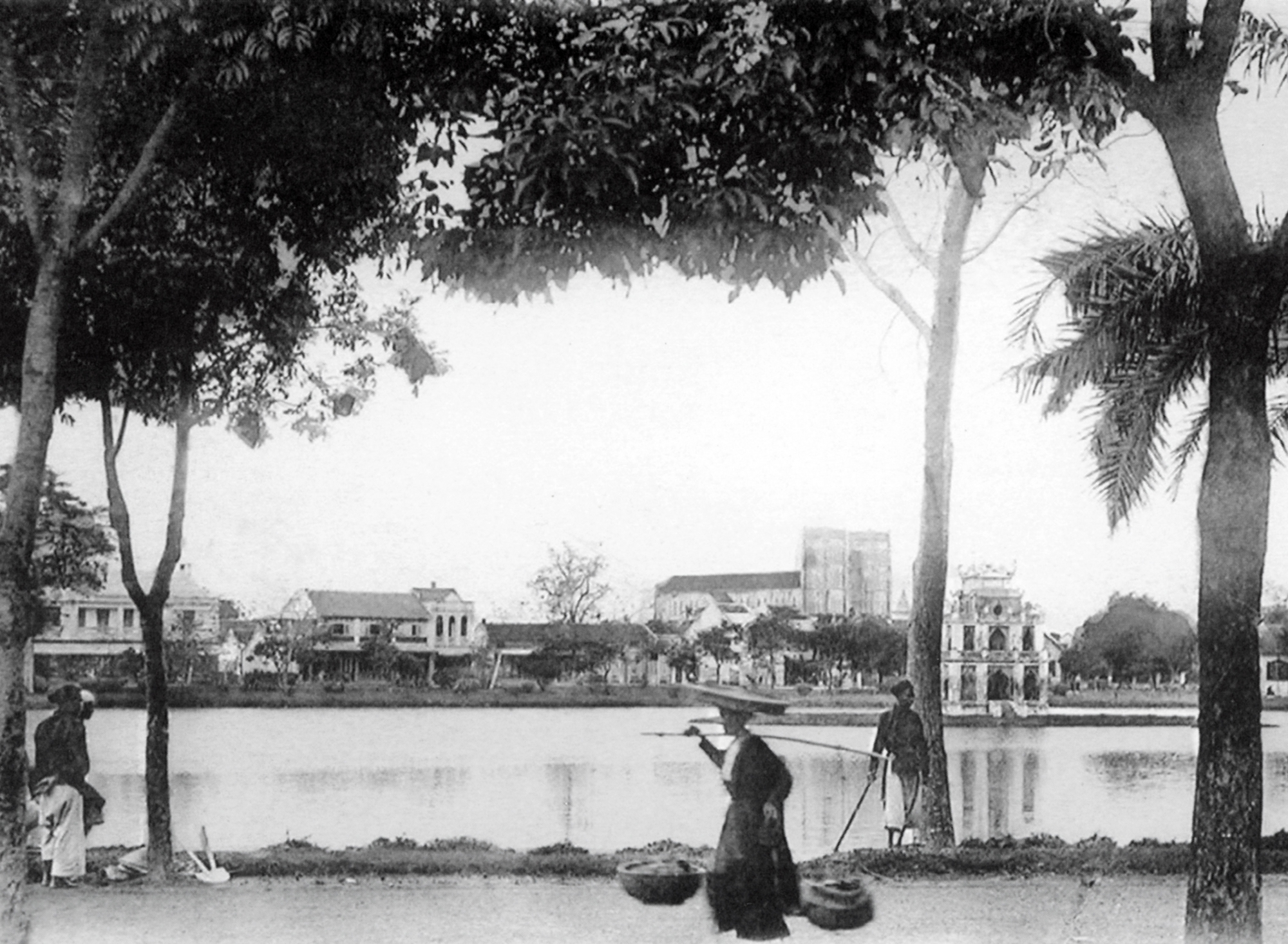 Photo of Hoan Kiem Lake, Hanoi, early 20th century. Copyright aka-images
